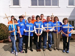 Team holding wooden crosses
