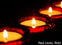 lit candles; photo by Paul Lewis, flickr creative commons