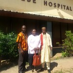 three health workers in front of hospital