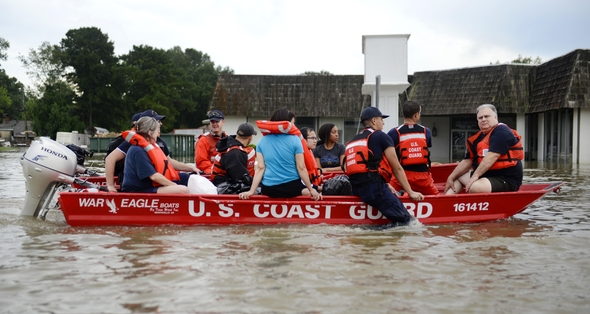 Coast Guardsmen rescue stranded residents from high water during severe flooding around Baton Rouge, LA on Aug. 14, 2016. Coast Guard photo by Petty Officer 3rd Class Brandon Giles
