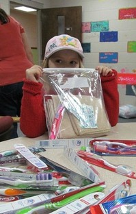 child with hygiene kit in bag