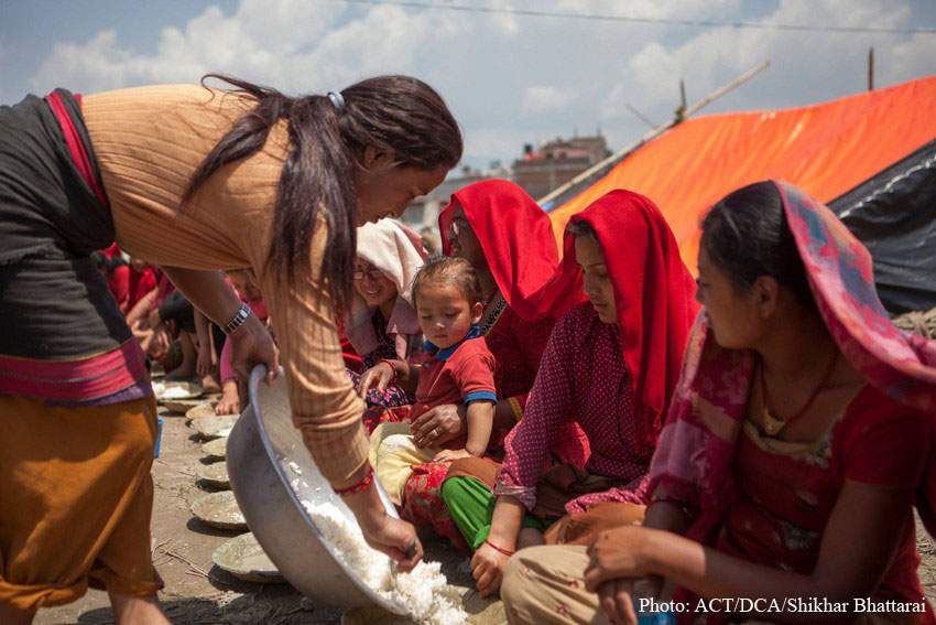 Women receive food from local ACT Alliance and DCA partners in Nepal.