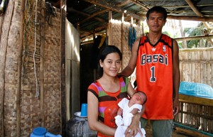 mother, father, and infant; photo by Christian Aid/ACT