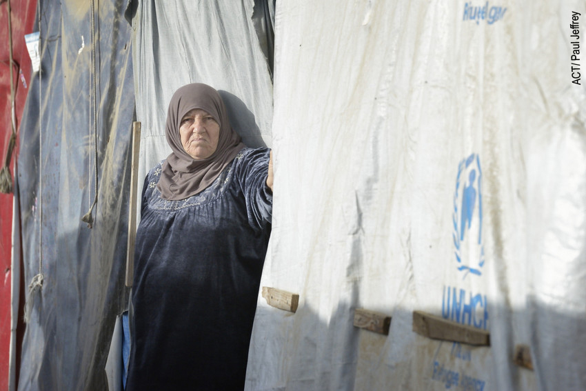 Syrian woman in front of tent