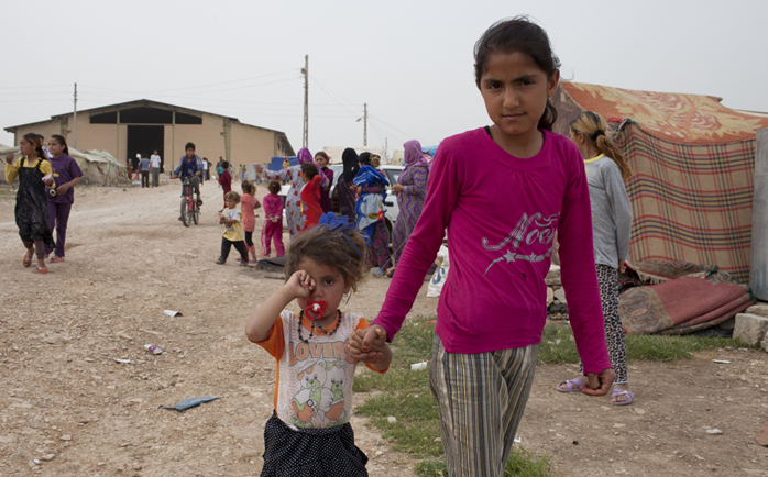children walking near tents