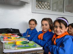 Syrian school children with school supplies
